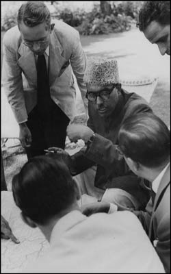 """""""One of the historic photographs taken by legendary photographer Henri Cartier-Bresson in Srinagar in 1948 shows a smoking Sheikh M Abdullah intercating with UN officials who were working on a map to draw CFL. The picture was recently availiable for auctioned at Christie."""