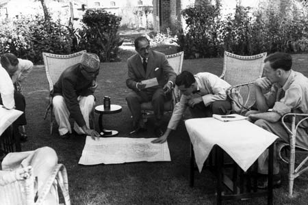 One of the historic photographs taken by legendary photographer Henri Cartier-Bresson in Srinagar in 1948 shows Sheikh Abdullah interacting with UN officials working on the map to create the cease fire line.