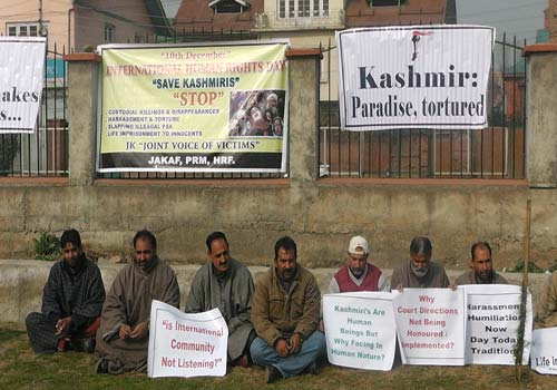 Former Kashmiri militants protesting against the harrasment and humilation method out to them by security agencies