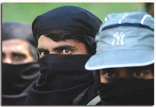 Three Kashmiri militants waiting for their turn to surrender in front of army in Srinagar