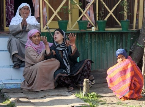 """PAIN: A Kashmiri woman consoles Hafiza (with arms raised), the owner of Houseboat """"New Beauty"""" where the British woman was found murdered on Saturday. Sara Elizabeth was staying with Hafiza's family who, they say, used to treat her like a daughter."""