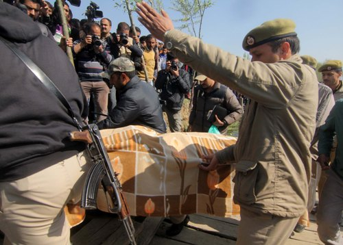ACTION: A large group of photojournalists gathered at the spot as Elizabeth's body was shifted to an ambulance from where it was taken to Rainawari hospital in Srinagar for post-mortem examination.