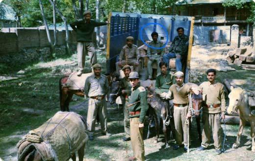 Abdul Rahman Ganie (encircled) in a seized truck and ponies.