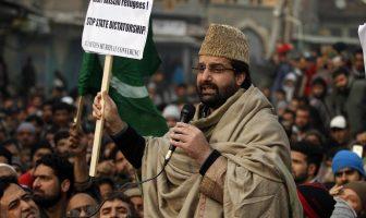 Mirwaiz Umar holding a playcard while addressing protesters outside Jamia Masjid Srinagar. KL Image by Bilal Bhadur