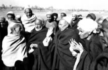 An undated photograph showing the village elders in a discussion.