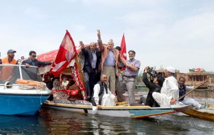 Dr Farooq Abdullah alongwith other party members during an election campaign in Dal Lake.
