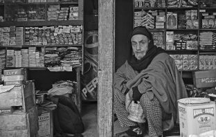 Ghulam Hassan Bangi at his shop. - Ruined Life - Kashmir Life - Story