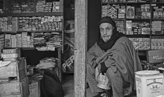 Ghulam Hassan Bangi at his shop. - Ruined Life - Kashmir Life - Story