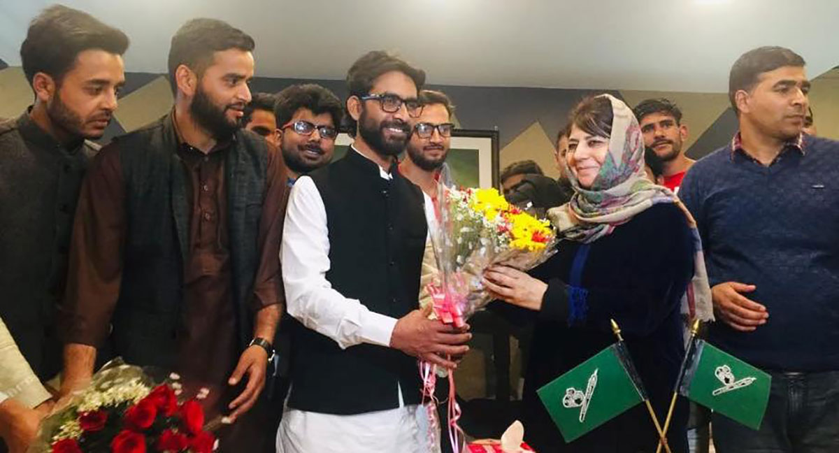 Mehbooba Mufti welcoming noted Bakerwal activist Talib Hussain into the party.