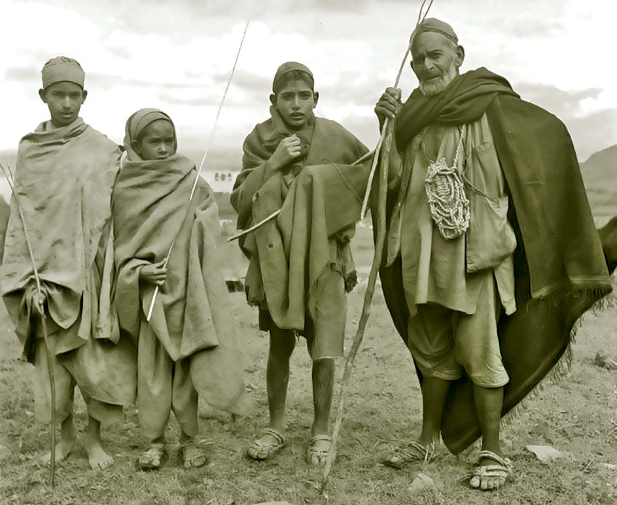 Traditional sheep-herders of Kashmir with their locally made grass slippers.