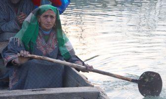 Jana Begum rowing her boat. KL Image by Samreena Nazir