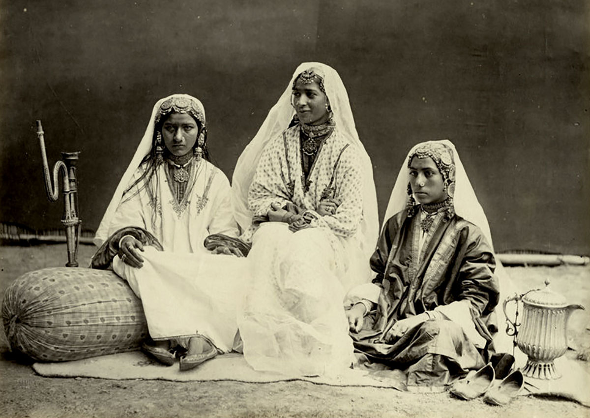 An 1870 photograph showing the famed Kashmir Nautch Girls in a group photograph.