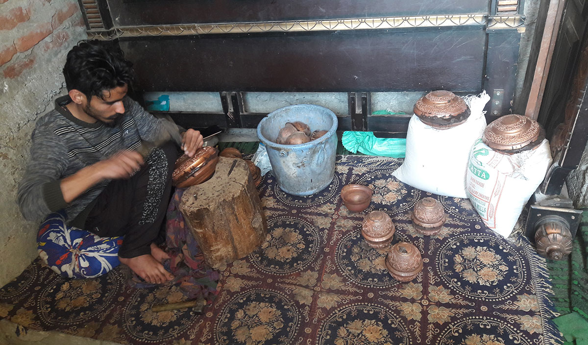 Faizan, Bashir's son working as a copper smith.