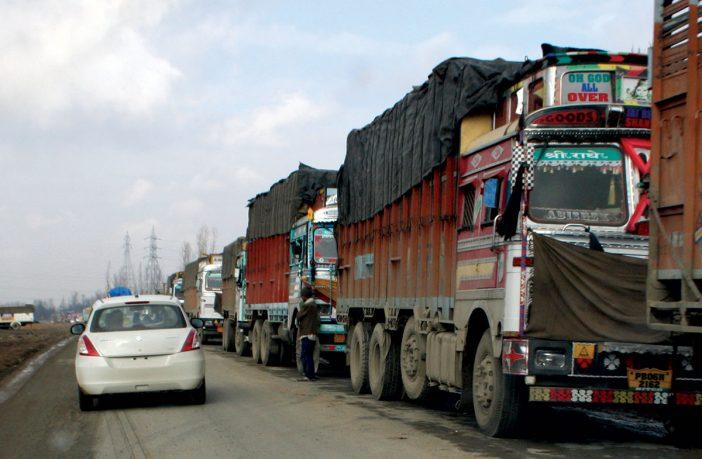 Long line of stranded trucks on a road. KL Image by Bilal Bahadur