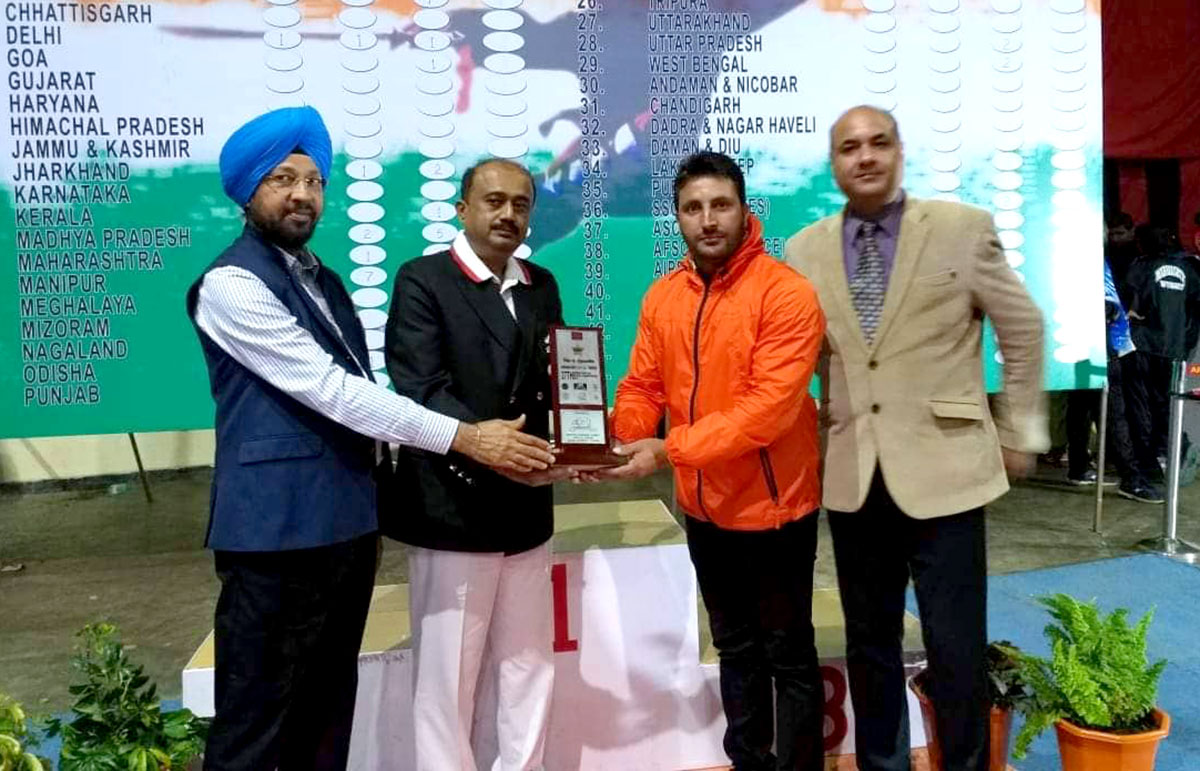Nisar Ahmad Mir receiving award at a National Level Wushu Competition.