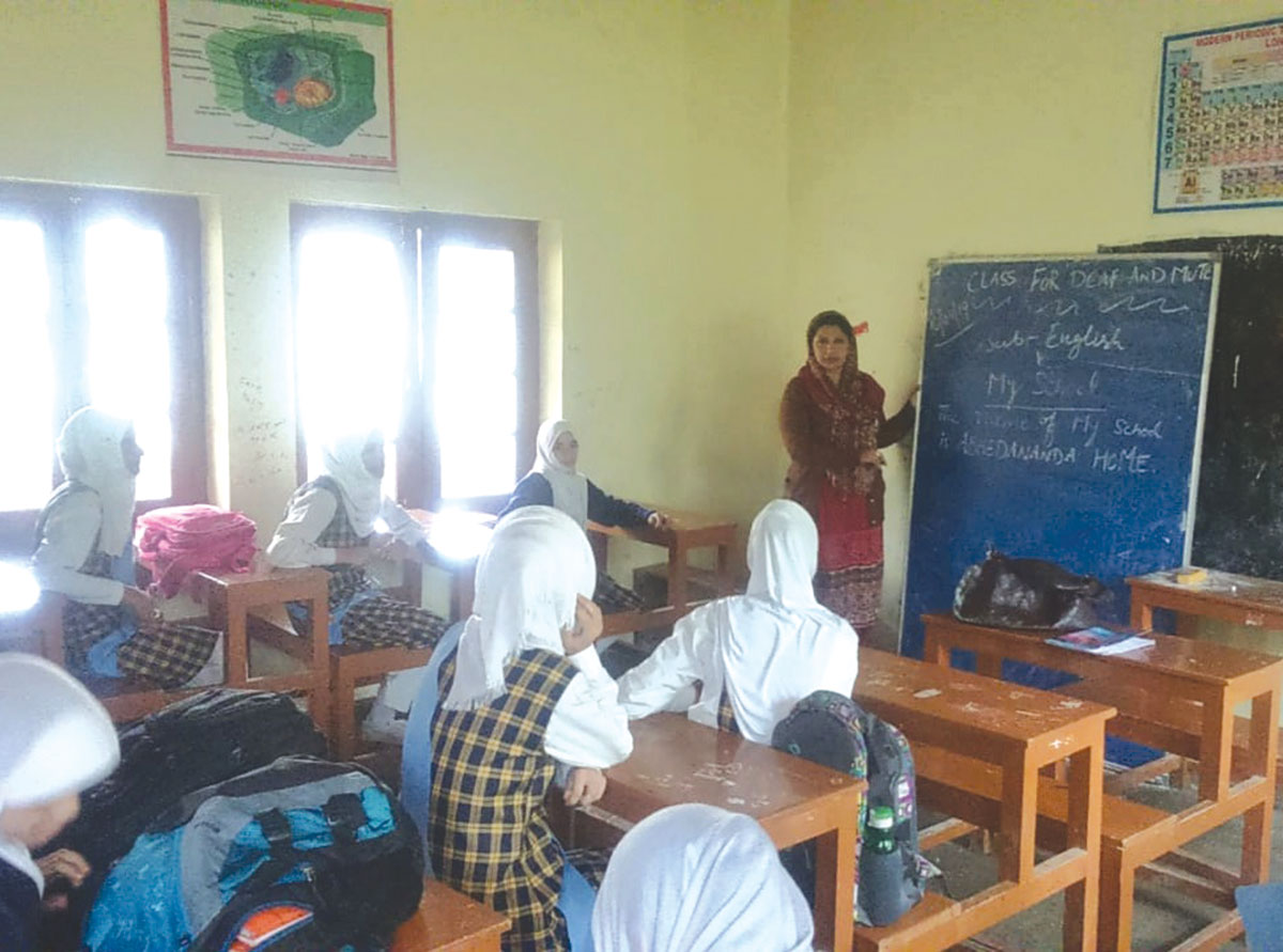 Farzana teaching deaf and dumb students at school.