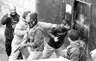 Photojournalist being beaten by forces during covering an encounter in Srinagar.