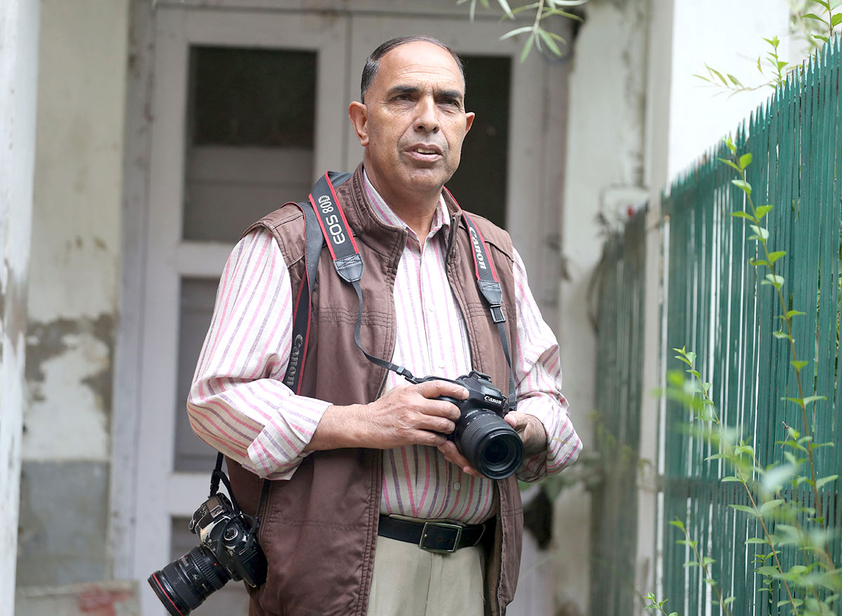Senior photojournalist, Nissar Ahmed working in the hindu from Jammu and Kashmir.