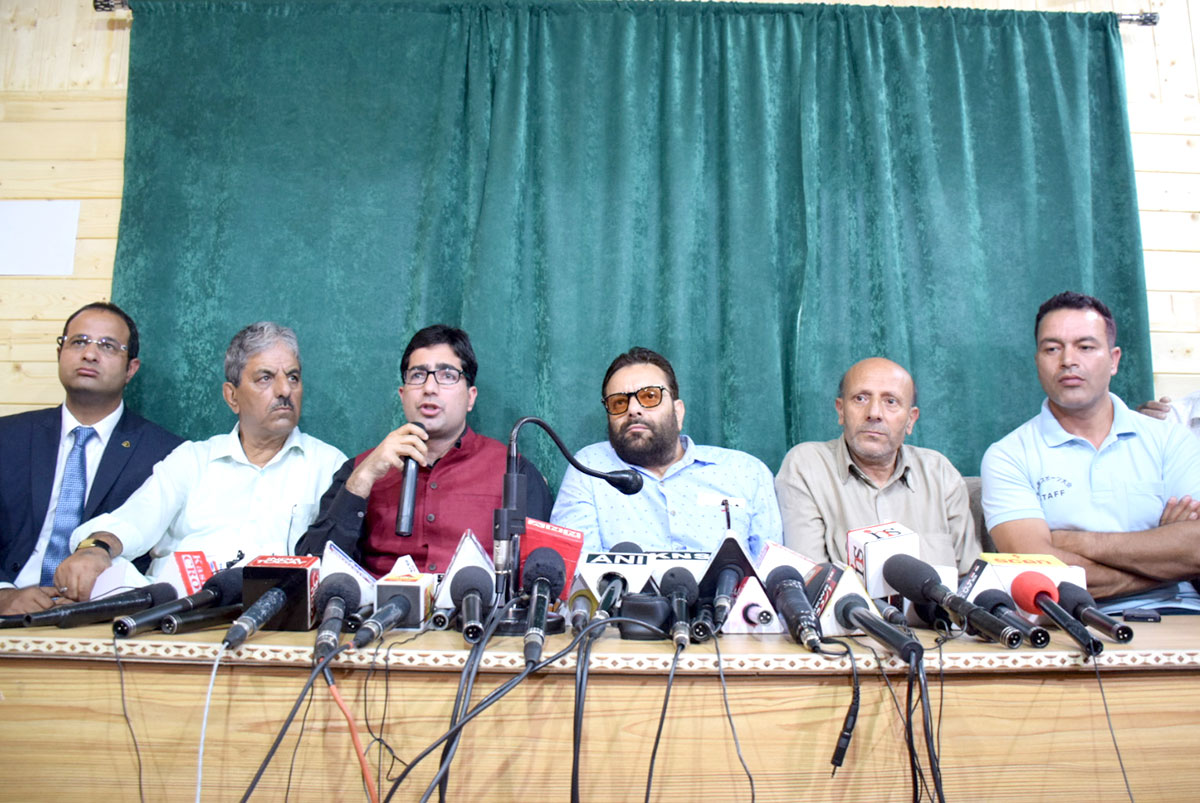 Shah FAesal and Er Rasheed in a press conference.