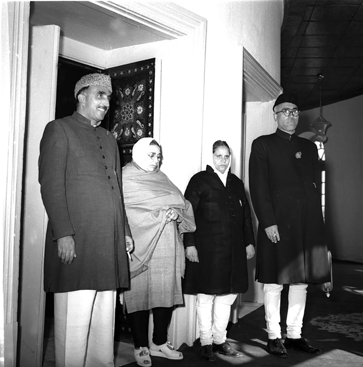Sheikh Abdullah and Bakshi Ghulam Mohammed with Iswari Devi Maini and Rajender Singh, women-members of the Kashmir Constituent Assembly on October 31, 1951.