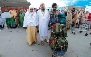Hajj pilgrims collecting their luggage at Haj House Srinagar.