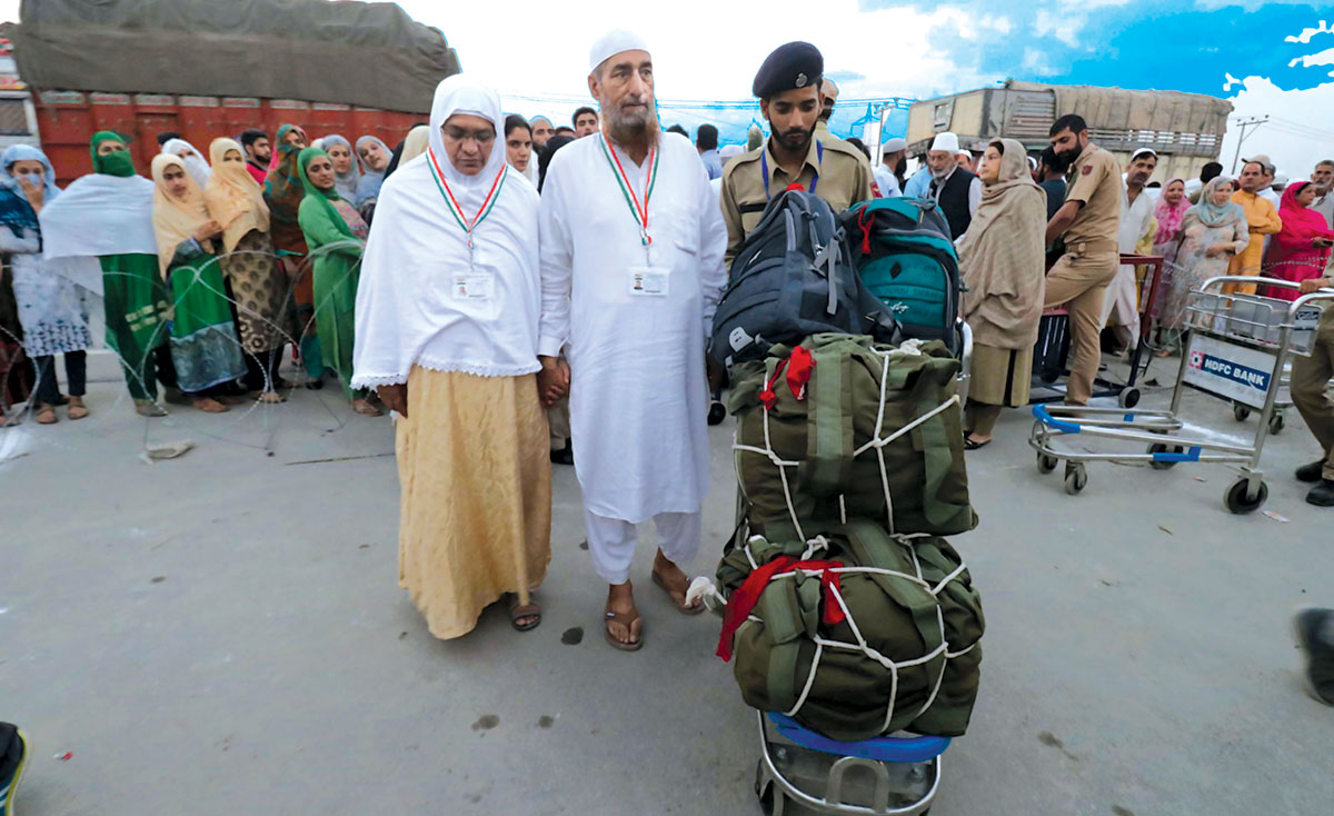 Hajj pilgrims collecting their luggage at Haj House Srinagar.