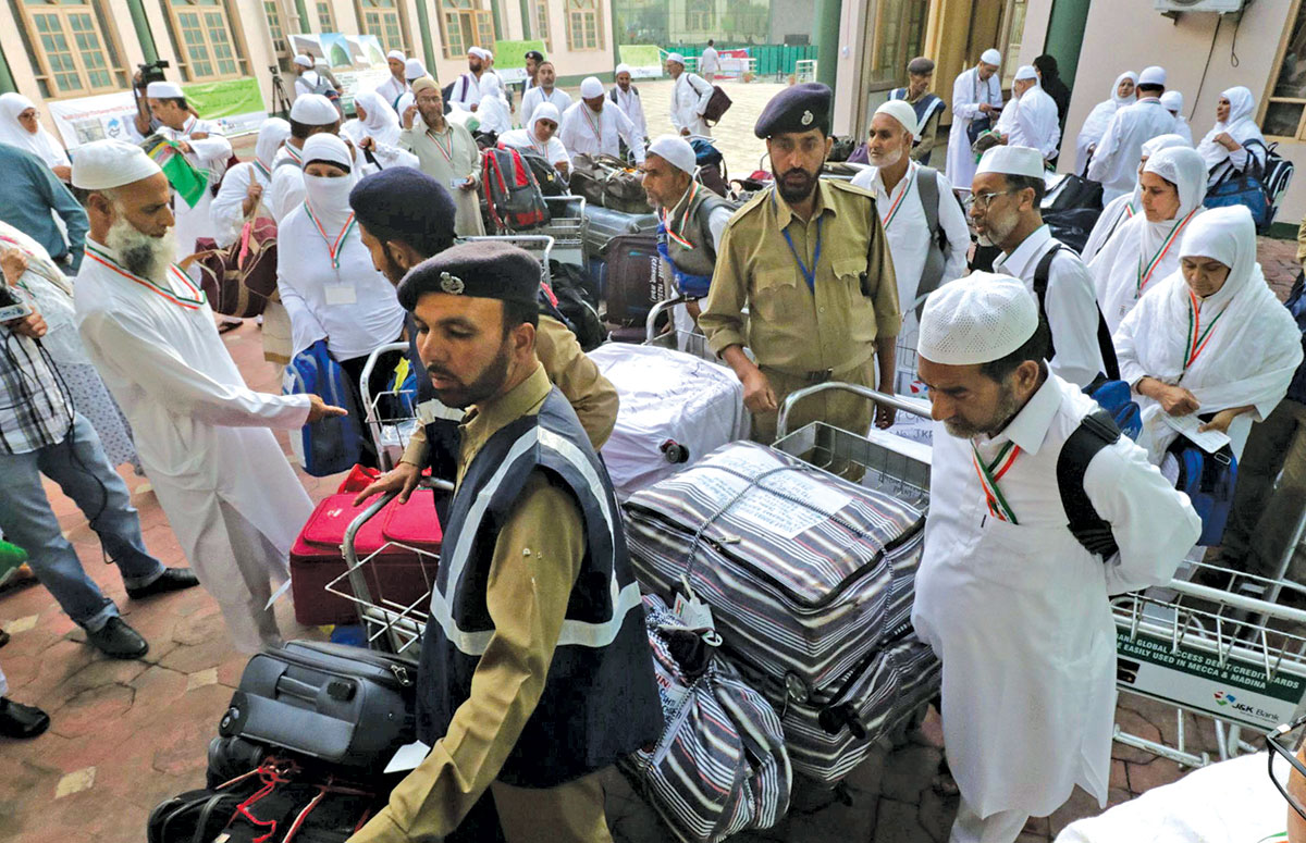 Hajj pilgrims collecting their luggage at Haj House Srinagar. KL Image by Bilal Bahadur