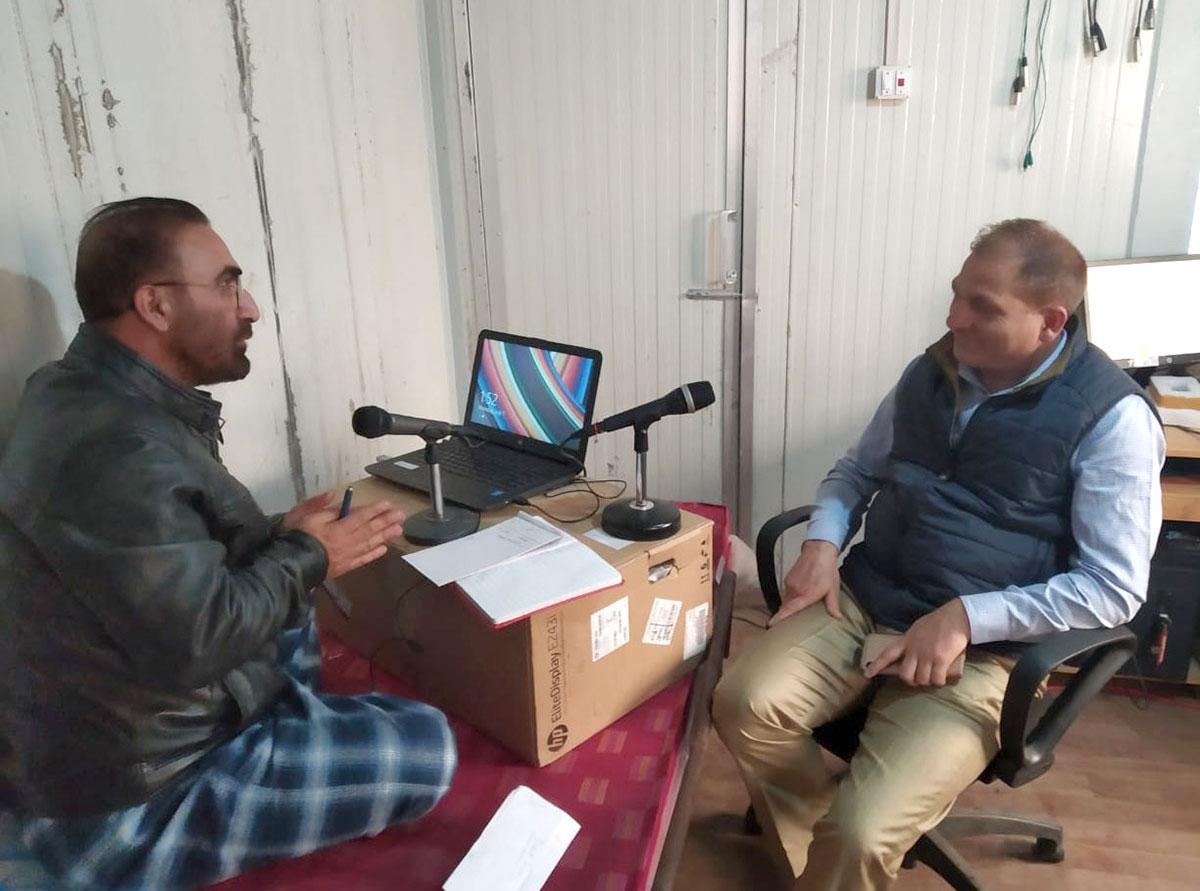 Talha Jehangir, the ace Radio Kashmir Srinagar broadcaster, manning the yatra radio transmissions at Baltal. Kl Image Special arrangement