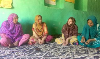(L to R) Posha and Shaista Rashid with other members during thier self help group's meeting in Shilwat village of Sumbal, Sonawari. KL Image by Shams Irfan