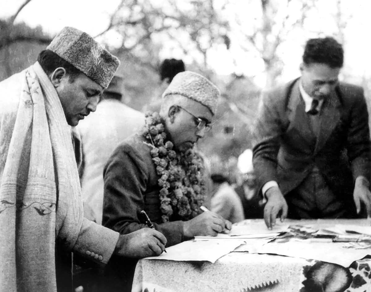 Sheikh Abdullah signing land to tiller ordinance. Aijaz Ashraf Wani Whither Governance? Kashmir