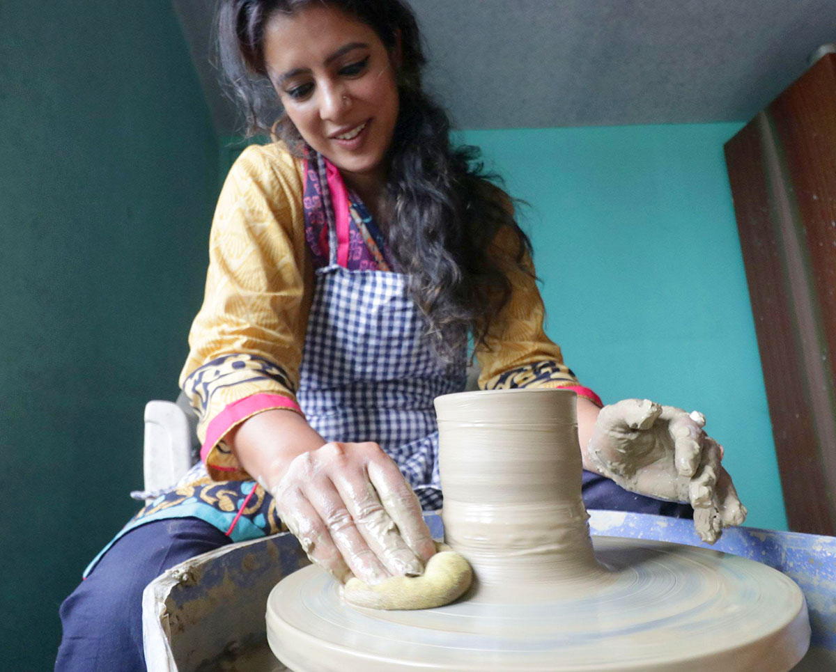 Saima during her pottery work. (KL Image by Bilal Bahadur)