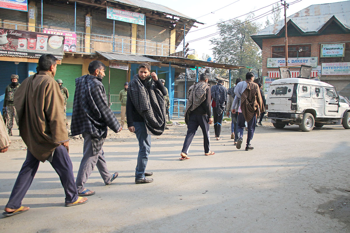 Locals being frisked by the armed forces in Kulgam. KL Image by Bilal Bahadur
