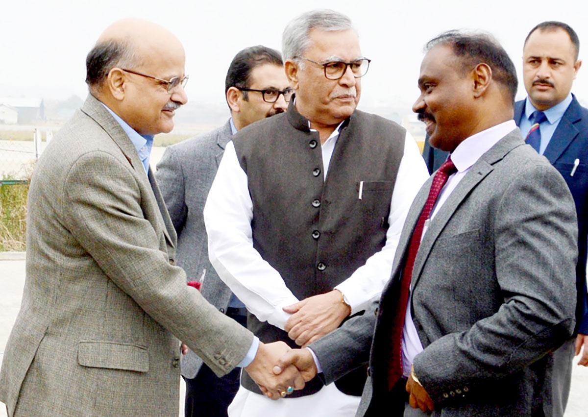 Chief Secretary BVR Subramanium greets Lt Governor GC Murmu.