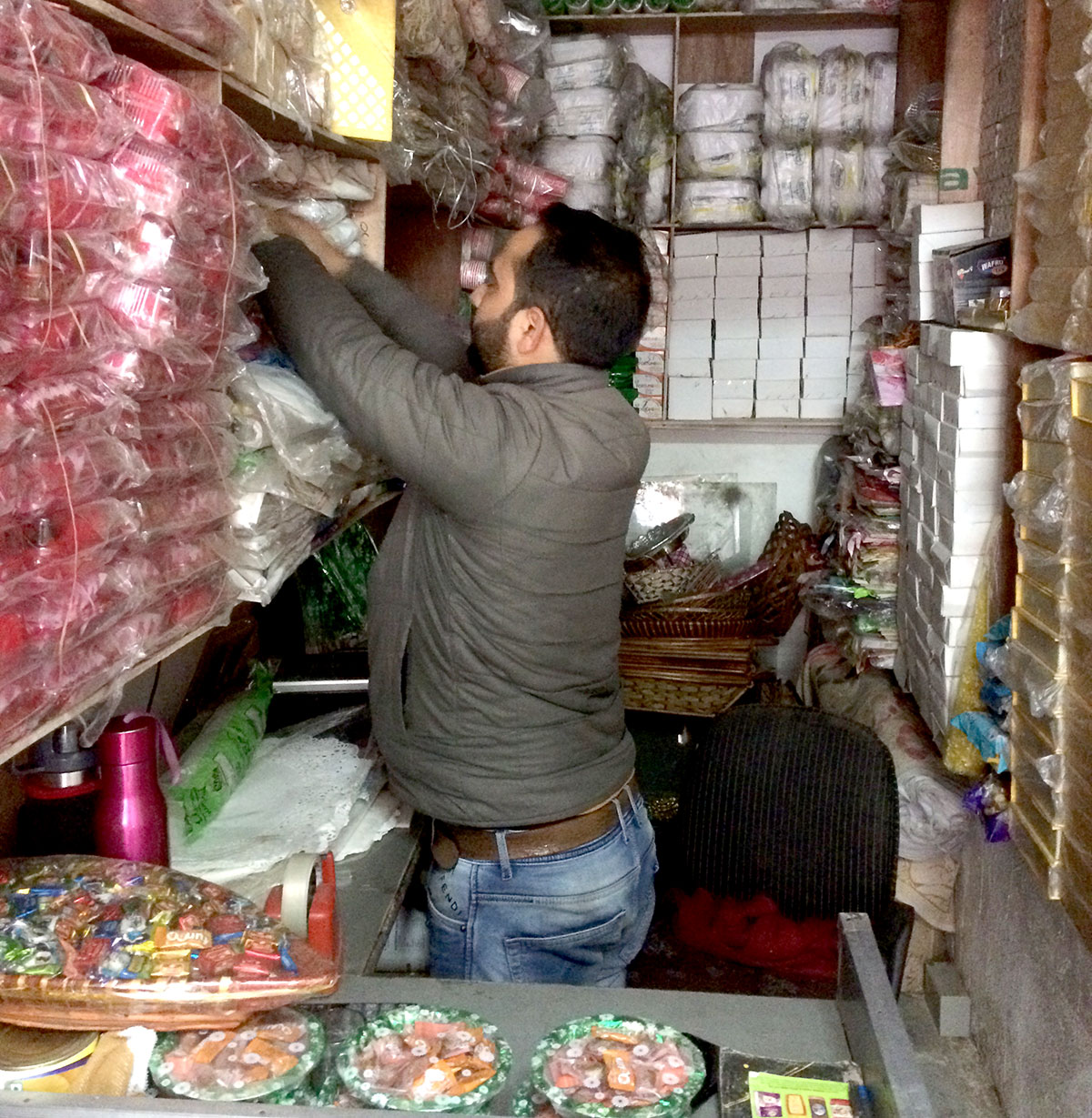 Mir Waseem working as helper at his uncle's shop in main town Anantnag. KL Image by Umar Khurshid