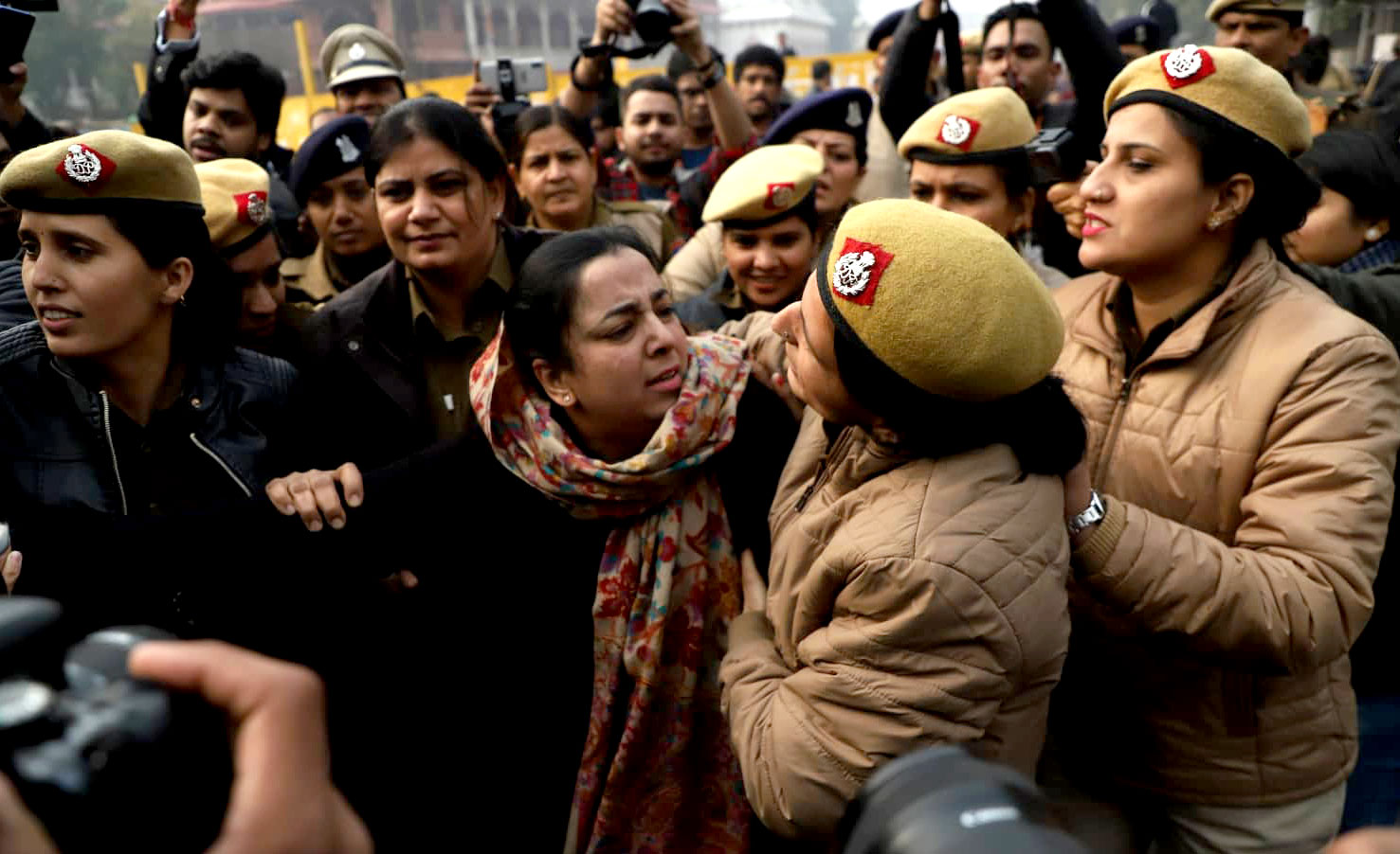 Police arrests a lady protestor near Red Fort, Delhi. Image by Nasir Kachroo