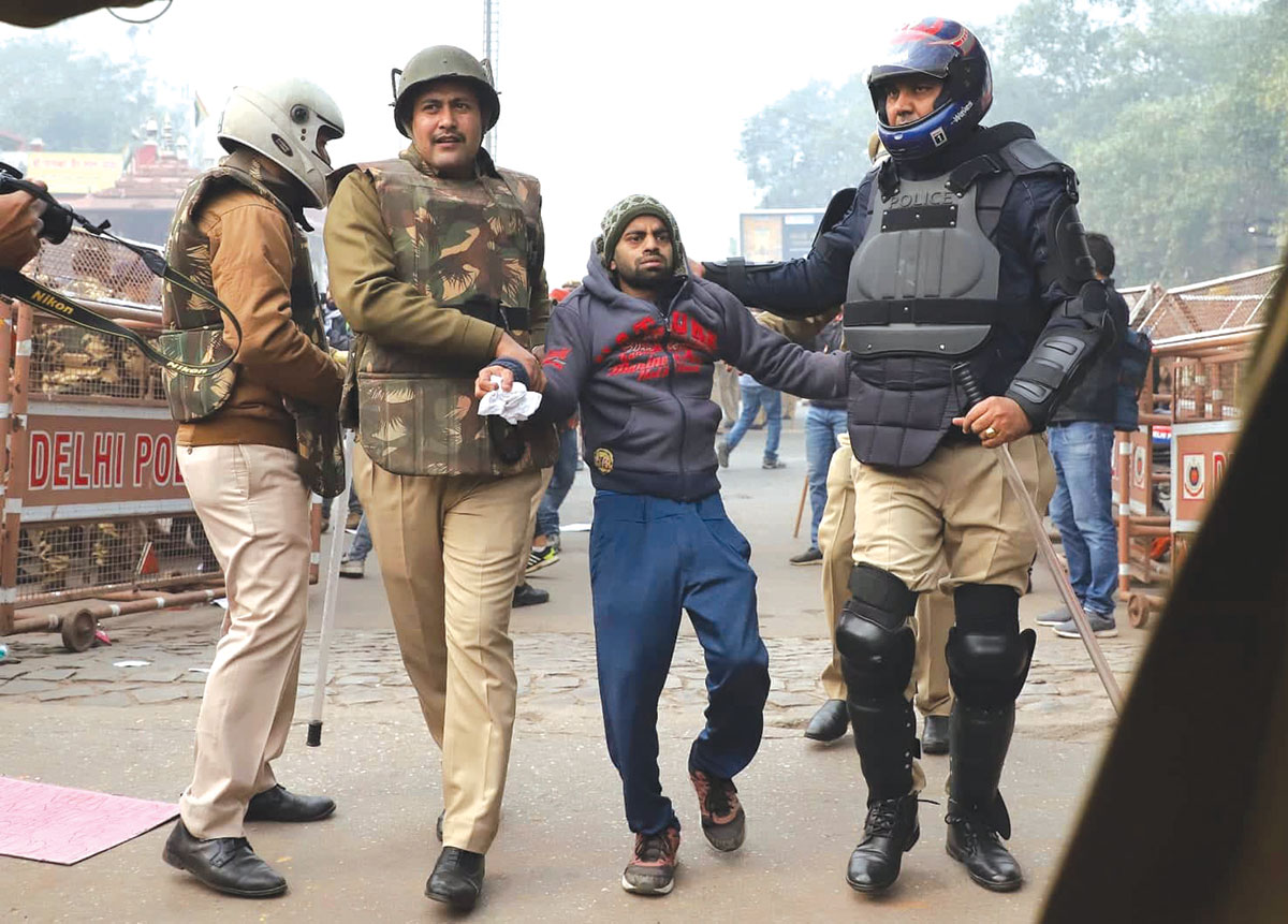 Police arrests a protestor near historic Red Fort in New Delhi. Image by Nasir Kachroo