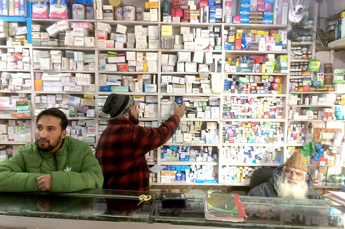 Rehmani Sameer selling medicines at his brother's chemist shop in Janglat Mandi Anantnag. KL Image by Umar Khurshid